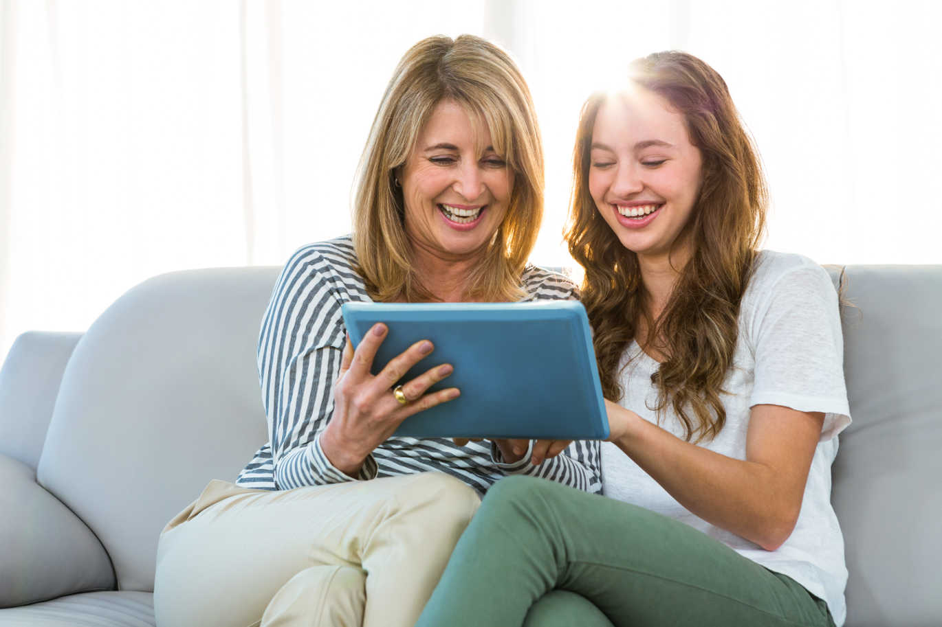 mother and daughter looking at ipad